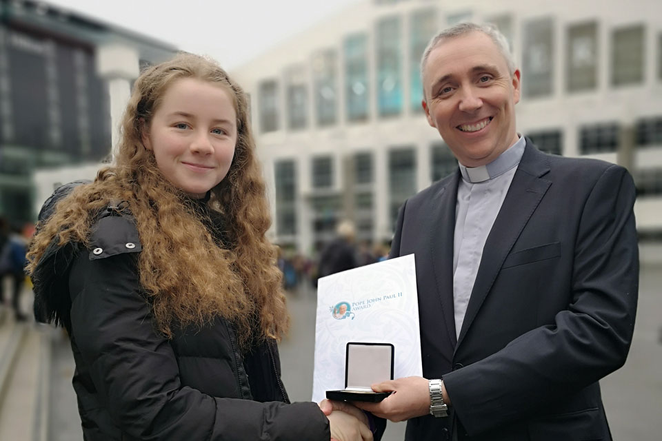 Fr Paul Farren, Award Director presents Olivia Bennett, St Mary's Parish, Windsor, England with the Gold Award